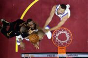 LeBron James #23 of the Cleveland Cavaliers drives to the basket against David West #3 and Stephen Curry #30 of the Golden State Warriors in the first half during Game Four of the 2018 NBA Finals at Quicken Loans Arena on June 8, 2018 in Cleveland, Ohio. NOTE TO USER: User expressly acknowledges and agrees that, by downloading and or using this photograph, User is consenting to the terms and conditions of the Getty Images License Agreement.