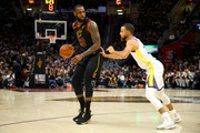 LeBron James #23 of the Cleveland Cavaliers drives to the basket defended by Stephen Curry #30 of the Golden State Warriors during Game Four of the 2018 NBA Finals at Quicken Loans Arena on June 8, 2018 in Cleveland, Ohio. NOTE TO USER: User expressly acknowledges and agrees that, by downloading and or using this photograph, User is consenting to the terms and conditions of the Getty Images License Agreement.