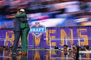 Lamar Jackson of Louisville hugs NFL Commissioner Roger Goodell after being picked #32 overall by the Baltimore Ravens during the first round of the 2018 NFL Draft at AT&T Stadium on April 26, 2018 in Arlington, Texas.