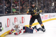 John Carlson #74 of the Washington Capitals attempts to control the puck against James Neal #18 of the Vegas Golden Knights during the first period in Game Five of the 2018 NHL Stanley Cup Final at T-Mobile Arena on June 7, 2018 in Las Vegas, Nevada.
