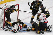 (L-R) Colin Miller #6, Marc-Andre Fleury #29 and Luca Sbisa #47 of the Vegas Golden Knights defend the net from a shot by Christian Djoos (not pictured) #29 of the Washington Capitals in front of Lars Eller #20 of the Capitals and Tomas Tatar #90 and Cody Eakin #21 of the Golden Knights in the second period of Game Five of the 2018 NHL Stanley Cup Final at T-Mobile Arena on June 7, 2018 in Las Vegas, Nevada. The Capitals defeated the Golden Knights 4-3.