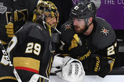 Marc-Andre Fleury #29 and Shea Theodore #27 of the Vegas Golden Knights talk at the bench in the second period of Game Five of the 2018 NHL Stanley Cup Final against the Washington Capitals at T-Mobile Arena on June 7, 2018 in Las Vegas, Nevada. The Capitals defeated the Golden Knights 4-3.