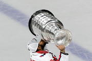 Devante Smith-Pelly #25 of the Washington Capitals kisses the Stanley Cup after Game Five of the 2018 NHL Stanley Cup Final at T-Mobile Arena on June 7, 2018 in Las Vegas, Nevada. The Capitals defeated the Golden Knights 4-3 and won the series four games to one.