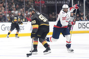 Tomas Tatar #90 of the Vegas Golden Knights is defended by Devante Smith-Pelly #25 of the Washington Capitals during the first period in Game Five of the 2018 NHL Stanley Cup Final at T-Mobile Arena on June 7, 2018 in Las Vegas, Nevada.