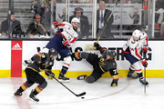 John Carlson #74 of the Washington Capitals defends James Neal #18 of the Vegas Golden Knights as William Karlsson #71 falls to the ice during the first period in Game Five of the 2018 NHL Stanley Cup Final at T-Mobile Arena on June 7, 2018 in Las Vegas, Nevada.