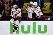 Brett Connolly #10, Devante Smith-Pelly #25 and Jay Beagle #83 of the Washington Capitals celebrate their 4-3 win over the Vegas Golden Knights to win the Stanley Cup in Game Five of the 2018 NHL Stanley Cup Final at T-Mobile Arena on June 7, 2018 in Las Vegas, Nevada.