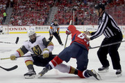 Pierre-Edouard Bellemare #41 of the Vegas Golden Knights and Jay Beagle #83 of the Washington Capitals battle for the puck during the second period in Game Four of the 2018 NHL Stanley Cup Final at Capital One Arena on June 4, 2018 in Washington, DC.