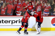 Devante Smith-Pelly #25 of the Washington Capitals celebrates with his teammate Braden Holtby #70 after scoring a goal on Marc-Andre Fleury #29 of the Vegas Golden Knights during the third period in Game Three of the 2018 NHL Stanley Cup Final at Capital One Arena on June 2, 2018 in Washington, DC.