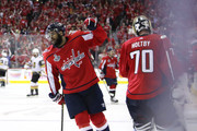 Devante Smith-Pelly #25 is congratulated by his teammate Braden Holtby #70 after scoring a third-period goal against the Vegas Golden Knights in Game Three of the 2018 NHL Stanley Cup Final at Capital One Arena on June 2, 2018 in Washington, DC.