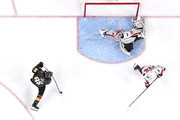 Braden Holtby #70 of the Washington Capitals makes a diving stick-save on Alex Tuch #89 of the Vegas Golden Knights during the third period in Game Two of the 2018 NHL Stanley Cup Final at T-Mobile Arena on May 30, 2018 in Las Vegas, Nevada. The Capitals defeated the Golden Knights 3-2.