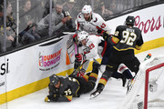 Ryan Reaves #75 of the Vegas Golden Knights crashes to the ice against Christian Djoos #29 and Tom Wilson #43 of the Washington Capitals as Tomas Nosek #92 looks on in Game Two of the 2018 NHL Stanley Cup Final at T-Mobile Arena on May 30, 2018 in Las Vegas, Nevada.