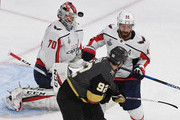 Braden Holtby #70 of the Washington Capitals blocks a shot as Tomas Nosek #92 of the Vegas Golden Knights and Brooks Orpik #44 of the Capitals fight for position in front of the net in the first period of Game Two of the 2018 NHL Stanley Cup Final at T-Mobile Arena on May 30, 2018 in Las Vegas, Nevada. The Capitals defeated the Golden Knights 3-2.