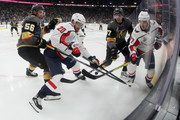 Lars Eller #20 and T.J. Oshie #77 of the Washington Capitals battles for the puck with Erik Haula #56 and David Perron #57 of the Vegas Golden Knights during the second period in Game Two of the 2018 NHL Stanley Cup Final at T-Mobile Arena on May 30, 2018 in Las Vegas, Nevada.