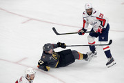 David Perron #57 of the Vegas Golden Knights is checked by Devante Smith-Pelly #25 of the Washington Capitals during the first period in Game Two of the 2018 NHL Stanley Cup Final at T-Mobile Arena on May 30, 2018 in Las Vegas, Nevada.