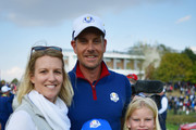 Henrik Stenson of Europe poses with his children and wife Emma Stenson and children during the afternoon foursome matches of the 2018 Ryder Cup at Le Golf National on September 28, 2018 in Paris, France.
