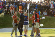 Sergio Garcia of Europe and Alex Noren of Europe confratulate Bubba Watson of the United States and Webb Simpson of the United States on victory during the afternoon foursome matches of the 2018 Ryder Cup at Le Golf National on September 29, 2018 in Paris, France.