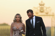 Dustin Johnson of the United States and his partner Paulina Gretzky arrive at the Ryder Cup Gala dinner at the Palace of Versailles ahead of the 2018 Ryder Cup on September 26, 2018 in Versailles, France.