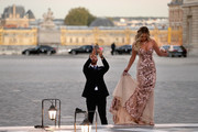 Dustin Johnson of the United States takes a picture of partner Paulina Gretzky before the 2018 Ryder Cup Gala dinner at the Palace of Versailles on September 26, 2018 in Paris, France.