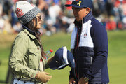 Rickie Fowler of the United States and fiance Allison Stokke during the morning fourball matches of the 2018 Ryder Cup at Le Golf National on September 29, 2018 in Paris, France.