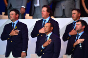 United States players observe the national anthem during the opening ceremony for the 2018 Ryder Cup at Le Golf National on September 27, 2018 in Paris, France.