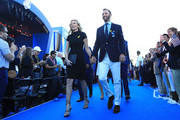 Dustin Johnson of the United States and partner Paulina Gretzky depart the opening ceremony for the 2018 Ryder Cup at Le Golf National on September 27, 2018 in Paris, France.