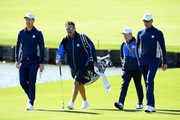 Justin Rose of Europe, caddie Mark Fulcher, putting coach Phil Kenyon and Henrik Stenson of Europe walk on the fairway during practice ahead of the 2018 Ryder Cup at Le Golf National on September 25, 2018 in Paris, France.