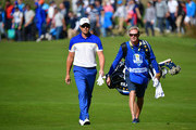 Henrik Stenson of Europe and caddie Gareth Lord walks fown the fairway during singles matches of the 2018 Ryder Cup at Le Golf National on September 30, 2018 in Paris, France.