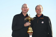Vice-Captain Steve Stricker of the United States and Captain Jim Furyk of the United States pose with The Ryder Cup trophy during a photocall ahead of the 2018 Ryder Cup at Le Golf National on September 26, 2018 in Paris, France.