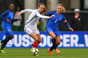 Jill Scott #8 of England battles for control of the ball with Amandine Henry #6 of France on March 1, 2018 at MAPFRE Stadium in Columbus, Ohio. England defeated France 4-1.