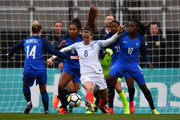 Jill Scott #8 of England keeps control of the ball among a host of French defenders in the first half against France on March 1, 2018 at MAPFRE Stadium in Columbus, Ohio.
