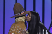 SZA (R) presents the Legend Award to Erykah Badu onstage during the 2018 Soul Train Awards at the Orleans Arena on November 17, 2018 in Las Vegas, Nevada.
