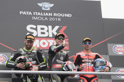 (L-R) Tom Sykes of Great Britain and KAWASAKI RACING TEAM WorldSBK,  Jonathan Rea  of Great Britain and KAWASAKI RACING TEAM WorldSBK and Marco Melandri of Italy and ARUBA.IT RACING-DUCATI celebrate on the podium at the end of the WorldSBK Race 1 during the 2018 Superbikes Italian Round  on May 12, 2018 in Imola, Italy.