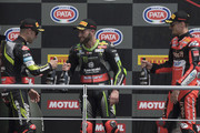 (L-R) Jonathan Rea (L) of Great Britain and KAWASAKI RACING TEAM WorldSBK, Tom Sykes of Great Britain and KAWASAKI RACING TEAM WorldSBK, Chaz Davies of Great Britain and ARUBA.IT RACING-DUCATI celebrate on the podium at the end of the Superbike race 2 during 2018 Superbikes Italian Round on May 13, 2018 in Imola, Italy.