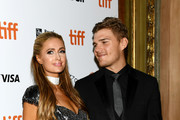 "Paris Hilton (L) and Chris Zylka attend the ""The Death And Life Of John F. Donovan"" premiere during 2018 Toronto International Film Festival at Winter Garden Theatre on September 10, 2018 in Toronto, Canada."