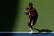 Venus Williams of the United States returns the ball during her women's singles second round match against Camila Giorgi of Italy on Day Three of the 2018 US Open at the USTA Billie Jean King National Tennis Center on August 29, 2018 in the Flushing neighborhood of the Queens borough of New York City.