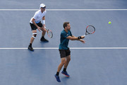 Jamie Murray of Great Britain and  Bruno Soares of Brazil returns a shot Guido Pella of Argentina and Albert Ramos-Vinolas of Spain during the men's doubles first round match on Day Four of the 2018 US Open at the USTA Billie Jean King National Tennis Center on August 30, 2018 in the Flushing neighborhood of the Queens borough of New York City.
