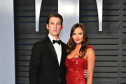 Miles Teller (L) and Keleigh Sperry attend the 2018 Vanity Fair Oscar Party hosted by Radhika Jones at Wallis Annenberg Center for the Performing Arts on March 4, 2018 in Beverly Hills, California.