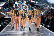 (L-R) Taylor Hill, Jasmine Tookes, Elsa Hosk, Adriana Lima, Behati Prinsloo, and Candice Swanepoel walk the runway during the 2018 Victoria's Secret Fashion Show at Pier 94 on November 8, 2018 in New York City.