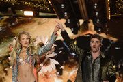 Romee Strijd and Andrew Taggart walk the runway during the 2018 Victoria's Secret Fashion Show at Pier 94 on November 08, 2018 in New York City.
