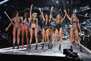 (L-R) Taylor Hill, Jasmine Tookes, Elsa Hosk, Adriana Lima, Behati Prinsloo, and Candice Swanepoel walk  the runway during the 2018 Victoria's Secret Fashion Show at Pier 94 on November 08, 2018 in New York City.