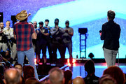 Jason Aldean (L) and Bobby Bones (R) honor first responders onstage during the 2018 iHeartRadio Music Festival at T-Mobile Arena on September 21, 2018 in Las Vegas, Nevada.