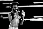Image has been converted to black and white.) Childish Gambino performs onstage during the 2018 iHeartRadio Music Festival at T-Mobile Arena on September 21, 2018 in Las Vegas, Nevada.