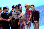 Jason Aldean (2nd from R) and Bobby Bones (R) honor first responders onstage during the 2018 iHeartRadio Music Festival at T-Mobile Arena on September 21, 2018 in Las Vegas, Nevada.