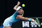 Caroline Wozniacki of Denmark plays a backhand in her first round match against Alison Van Uytvanck of Belgium during day one of the 2019 Australian Open at Melbourne Park on January 14, 2019 in Melbourne, Australia.