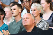 Jamie Murray (L) and Judy Murray look on as Andy Murray of Great Britain plays in his first round match against Roberto Bautista Agut of Spain during day one of the 2019 Australian Open at Melbourne Park on January 14, 2019 in Melbourne, Australia.