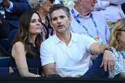 Eric Bana and Rebecca Gleeson watch the men's semi final match between Novak Djokovic of Serbia and Lucas Pouille of France during day 12 of the 2019 Australian Open at Melbourne Park on January 25, 2019 in Melbourne, Australia.