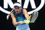 Caroline Wozniacki of Denmark plays a backhand in her second round match against  Johanna Larsson of Sweden during day three of the 2019 Australian Open at Melbourne Park on January 16, 2019 in Melbourne, Australia.
