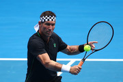 Pat Cash of Australia plays a backhand in his Legends Doubles match with Mark Woodforde of Australia against Wayne Ferreira of South Africa and Goran Ivanisevic of Croatia during day seven of the 2019 Australian Open at Melbourne Park on January 20, 2019 in Melbourne, Australia.