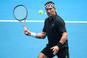 Pat Cash of Australia plays a forehand in his Legends Doubles match with Mark Woodforde of Australia against Wayne Ferreira of South Africa and Goran Ivanisevic of Croatia during day seven of the 2019 Australian Open at Melbourne Park on January 20, 2019 in Melbourne, Australia.