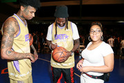 (L-R) Blueface and 2 Chainz sign a basketball for an attendee at the BETX Celebrity Basketball Game Sponsored By Sprite during the BET Experience at Los Angeles Convention Center on June 22, 2019 in Los Angeles, California.
